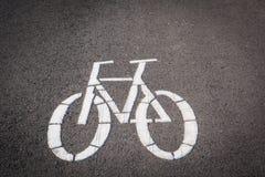 Символ велосипеда на дороге майны Стоковое Фото