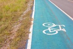 Символ велосипеда на улице Стоковые Фотографии RF