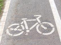 Символ велосипеда на улице Стоковая Фотография