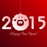 Символ овечки Нового Года на красном цвете Стоковое Фото