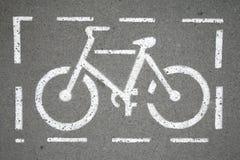 Символ пути велосипеда на улице города как предпосылка Стоковая Фотография