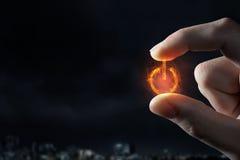 Символ силы между пальцами Стоковая Фотография