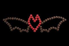 Символ хеллоуин - летучая мышь из круглых изолированных конфет Стоковое Изображение RF