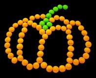 Символ хеллоуин - тыква Составленный малых круглых конфет Стоковая Фотография