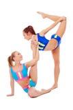 Симпатичные женские гимнасты нагревая в парах Стоковое Фото