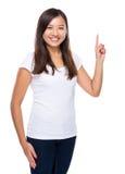 Сингапурский пункт пальца женщины вверх Стоковое Изображение
