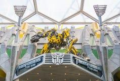 СИНГАПУР - 20,2015 -ГО ИЮЛЬ: ТРАНСФОРМАТОРЫ езда: Типичные 3 Стоковое Изображение RF