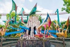 СИНГАПУР - 20-ОЕ ИЮЛЯ: Юрская тема парка в студиях Universal Si Стоковые Фото