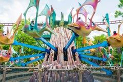 СИНГАПУР - 20-ОЕ ИЮЛЯ: Юрская тема парка в студиях Universal Si Стоковая Фотография RF