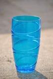 Синее стекло на конкретном поле Стоковые Фотографии RF
