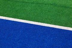 Синтетический крупный план боковой линии хоккея голубой и зеленый Стоковое Изображение RF