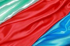 Синь и красный и салатовый silk материал бархата сатинировки текстуры Стоковое фото RF