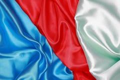 Синь и красный и салатовый silk материал бархата сатинировки текстуры Стоковая Фотография