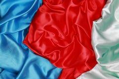 Синь и красный и салатовый silk материал бархата сатинировки текстуры Стоковая Фотография RF