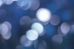 Синь освещает праздничное bokeh Стоковые Изображения