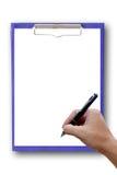 Синь доски сзажимом для бумаги с рукой. Стоковое Изображение