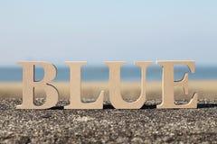 Синь слова сделанная с деревянным блоком Стоковое фото RF