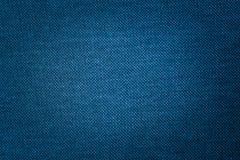 Синяя текстура ткани ткани которая структурно волокна текстильной ткани предпосылка использует нас космос для текста или отобража стоковая фотография