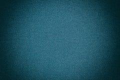 Синяя текстура ткани ткани которая структурно волокна текстильной ткани предпосылка использует нас космос для текста или отобража стоковые фотографии rf