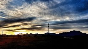 Сиротливые заходы солнца стоковые фотографии rf
