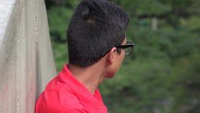 Сиротливый упущенный испанский предназначенный для подростков мальчик Стоковая Фотография RF