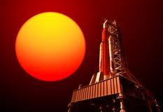 Система старта космоса на стартовой площадке и красном цвете Солнце Стоковая Фотография RF
