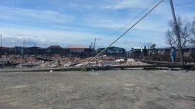 Ситуация после огня в Kampung Tanjung Batu Keramat Laut, Tawau, Сабахе, Малайзии Стоковая Фотография