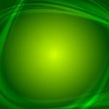 Сияющая зеленая волнистая абстрактная предпосылка Стоковые Фотографии RF