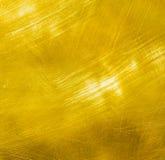 Сияющая почищенная щеткой предпосылка металла золота Стоковое Фото