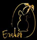 Сияющие лента и зайчик пасхального яйца золота Стоковое фото RF