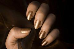 Сияющие золотые ногти Стоковые Фотографии RF