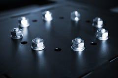 Сияющие стальные болты и гайки в круге Стоковая Фотография