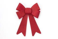 Сияющий красный смычок праздника на белизне Стоковое Фото