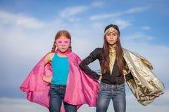 Сила девушки, супергерои стоковые изображения rf