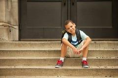 Сидеть вне школы Стоковые Изображения RF