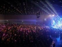 Сидеть людей наслаждается в концерте Стоковая Фотография