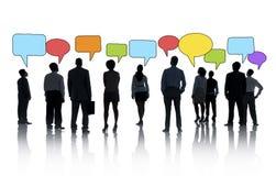 Силуэты бизнесменов и пузырей речи Стоковые Изображения RF