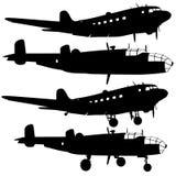 силуэты боевого самолета Стоковые Фотографии RF