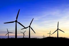 Силуэты ветрянки на восходе солнца Стоковое фото RF
