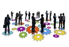 Силуэты группы в составе занятые бизнесмены Стоковое Фото