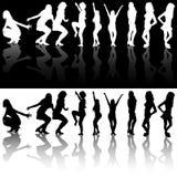 Силуэты девушек танцев Стоковая Фотография