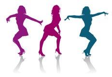 Силуэты девушек танцуя танец дам Стоковое Фото