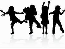 Силуэты детей танцев Стоковые Изображения RF
