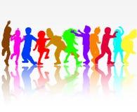 Силуэты детей танцев Стоковая Фотография