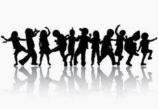 Силуэты детей танцев Стоковое Фото