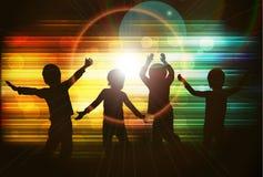 Силуэты детей танцев Стоковое Изображение