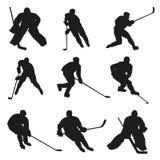 Силуэты игроков хоккея на льде Стоковые Фото