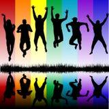 Силуэты молодые люди скакать Стоковое Изображение RF