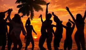 Силуэты разнообразный многонациональный Partying людей стоковое фото rf