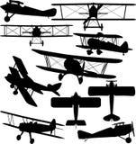 Силуэты старого аэроплана - самолет-биплана Стоковые Изображения
